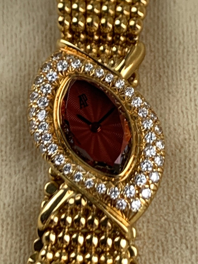 A Rare Audemars Piguet Ref: 40990 Bow Shaped 8 Karat Gold Cocktail Bracelet Watch, With Original Round Brilliant White Diamond Set in Pave (Premier Range) Over 46 pieces of 0.70 c.t. Diamonds Set Around 18 Karat Yellow Gold Dial. Fine 7 inches Long