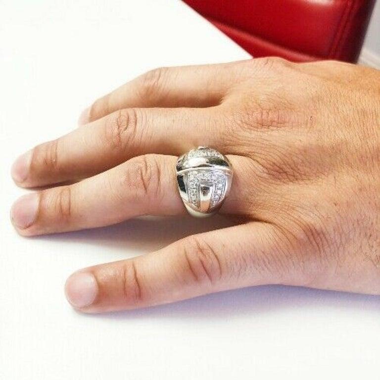 main stone: ROUND DIAMONDS 26PCS     carat total weight: 0.55     color: G     clarity: VS     brand: AUDEMARS PIGUET      metal: WHITE GOLD     type: ring     weight: 16.7 gr     size: 9 US     hallmark: 18K'750