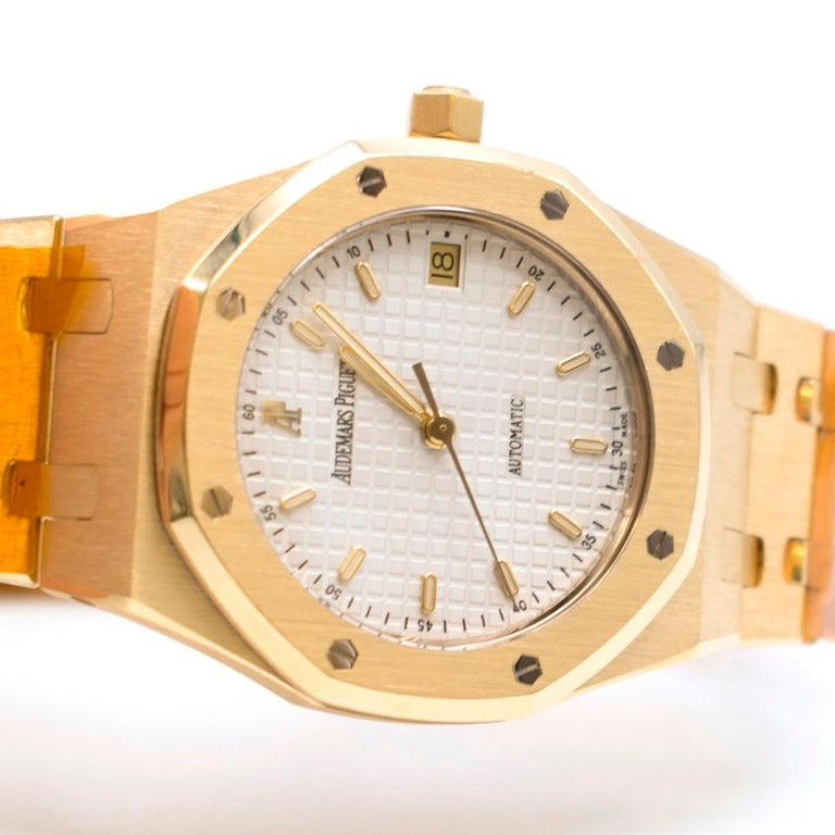Audemars Piguet 37mm Octagonal Royal Oak 18K Yellow Gold Watch  - Automatic movement - Swiss Made - Octagonal White Dial - 37mm  - 18ct Yellow Gold Strap and Case -Sapphire crystal glass face - Triple Folding Clasp - Water resistant to 500m - Has