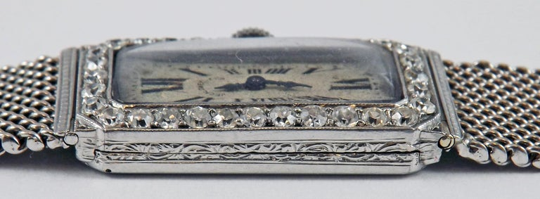 Gorgeous Art Deco lady's platinum diamond wristwatch by J.E. Caldwell. The original dial with black Roman numerals is signed