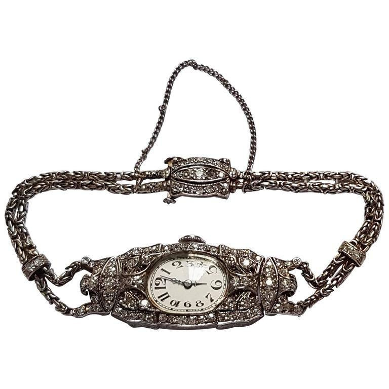 This delicate Audemars Piguet Art Deco Ladies Watch with Byzantine double rope chain (including safety chain) shows extraordinary craftsmanship. The watch is made of platinum and diamonds, the dial is silvered with Arabic numerals. It was recently