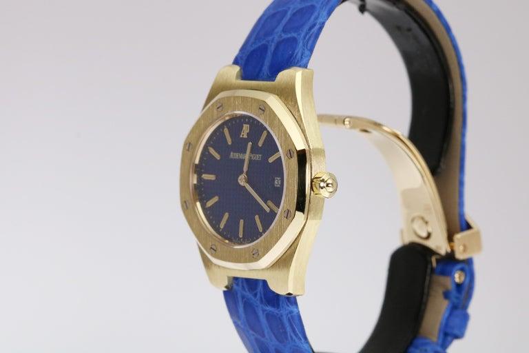 Audemars Piguet Ladies 18k yellow gold Royal Oak wristwatch. This watch comes with strap, service box and service papers.   Brand: Audemars Piguet  Model number:  66800BA.00.D129xx.01 Gender: Ladies Series: Royal Oak  Watch Style: Luxury  Case