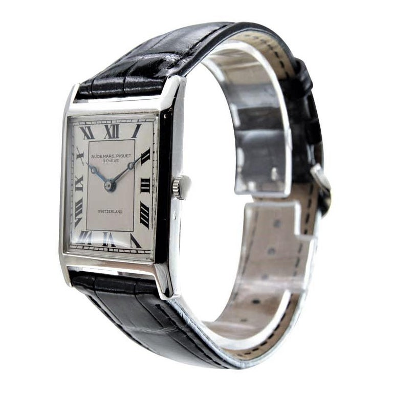 FACTORY / HOUSE: Audemars Piguet & Co. STYLE / REFERENCE: Art Deco / Tank Style METAL / MATERIAL: Platinum CIRCA / YEAR: 1930's DIMENSIONS / SIZE:  37mm X 26mm MOVEMENT / CALIBER: Manual Winding / 18 Jewels  DIAL / HANDS: Silvered with Roman