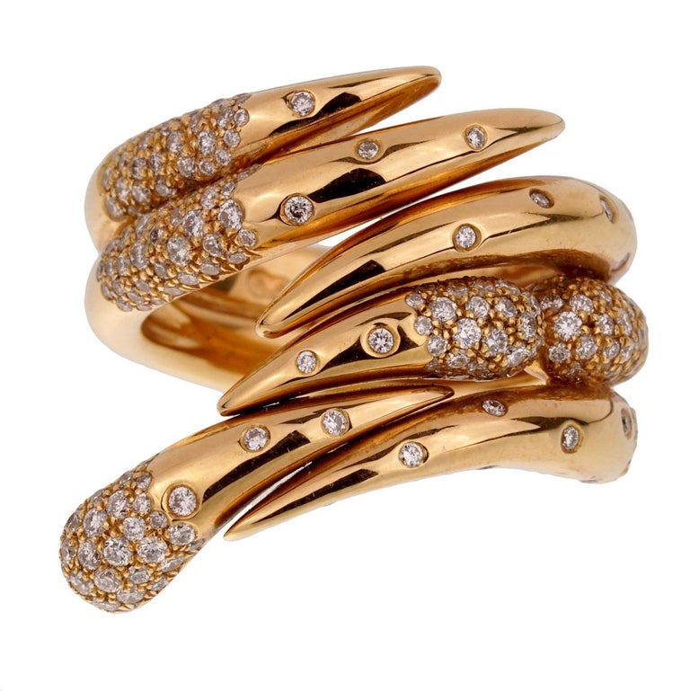 A chic Audemars Piguet diamond cocktail ring adorned with round brilliant cut diamonds in 18k rose gold. The ring measures a size 6 1/2 and can be resized.
