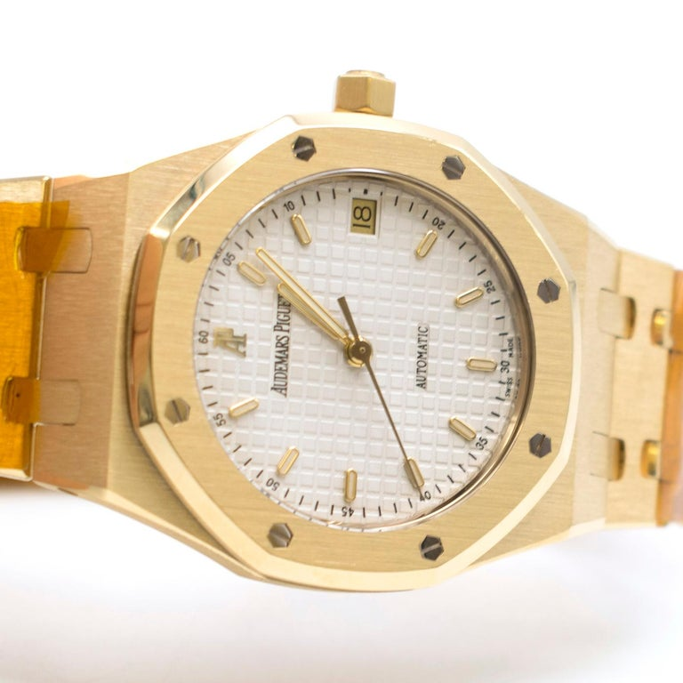 Audemars Piguet 37mm Octagonal Royal Oak 18K Yellow Gold Watch  - Automatic movement - Swiss Made - Octagonal White Dial - 37mm  - 18ct Yellow Gold Strap and Case -Sapphire crystal glass face - Triple Folding Clasp - Water resistant to 500m  Please