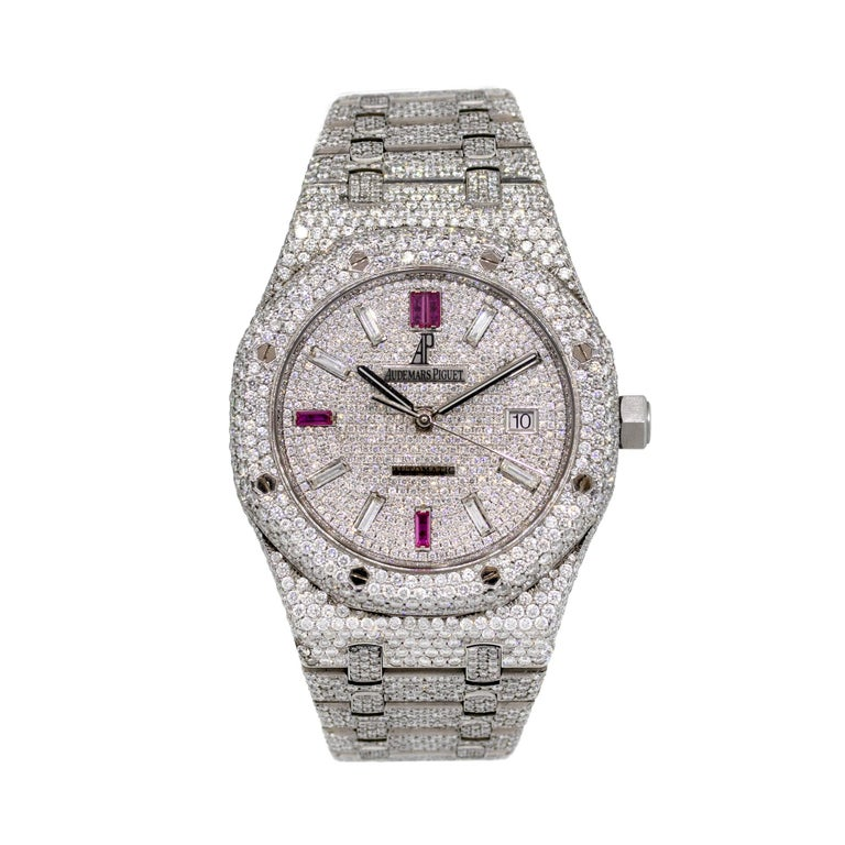 Brand: Audemars Piguet MPN: 15400st Model: Royal Oak Case Material: Stainless Steel Case Diameter: 41mm Crystal: Scratch resistant sapphire Bezel: Round brilliant diamonds (aftermarket) Dial: All diamond dial with Ruby Markers at 6,9, and 12 o'clock