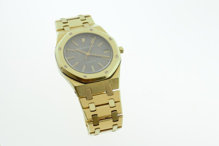 Audemars Piguet Royal Oak 34mm yellow gold ladies watch with grey dial. Excellent condition. The watch has just been fully serviced and polished with guarantee from Manhattan Time Service available till 2/24/2021. With original box. No papers.