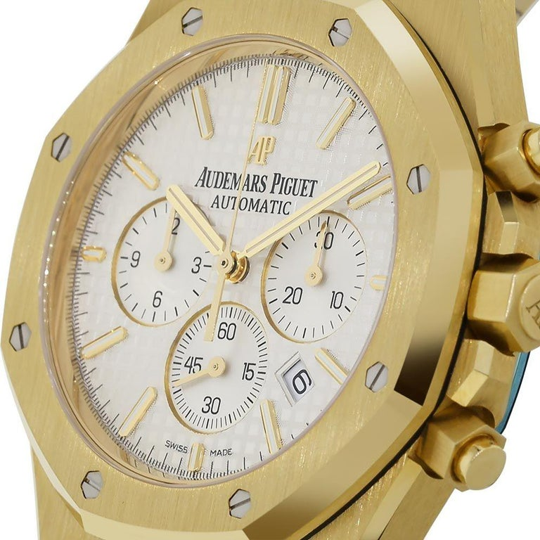 Audemars Piguet Royal Oak Chronograph  39mm yellow gold watch with white dial. Excellent condition. With original box and papers.   Viewings available in our NYC showroom by appointment.