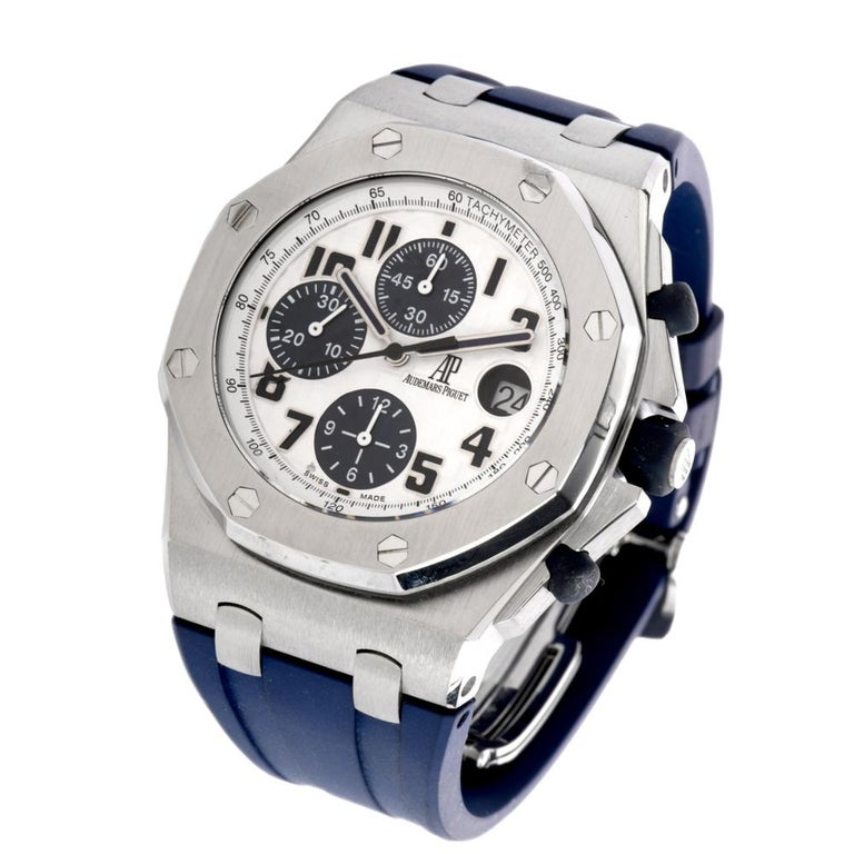 This CollectableRoyal Oak Offshore Chronograph  Automatic watch with Ref number 18117 features a white tapisserie dial with navy blue accents.  Date display is located at the 3 o'clock position.  This timepiece is in overall excellent mint condition