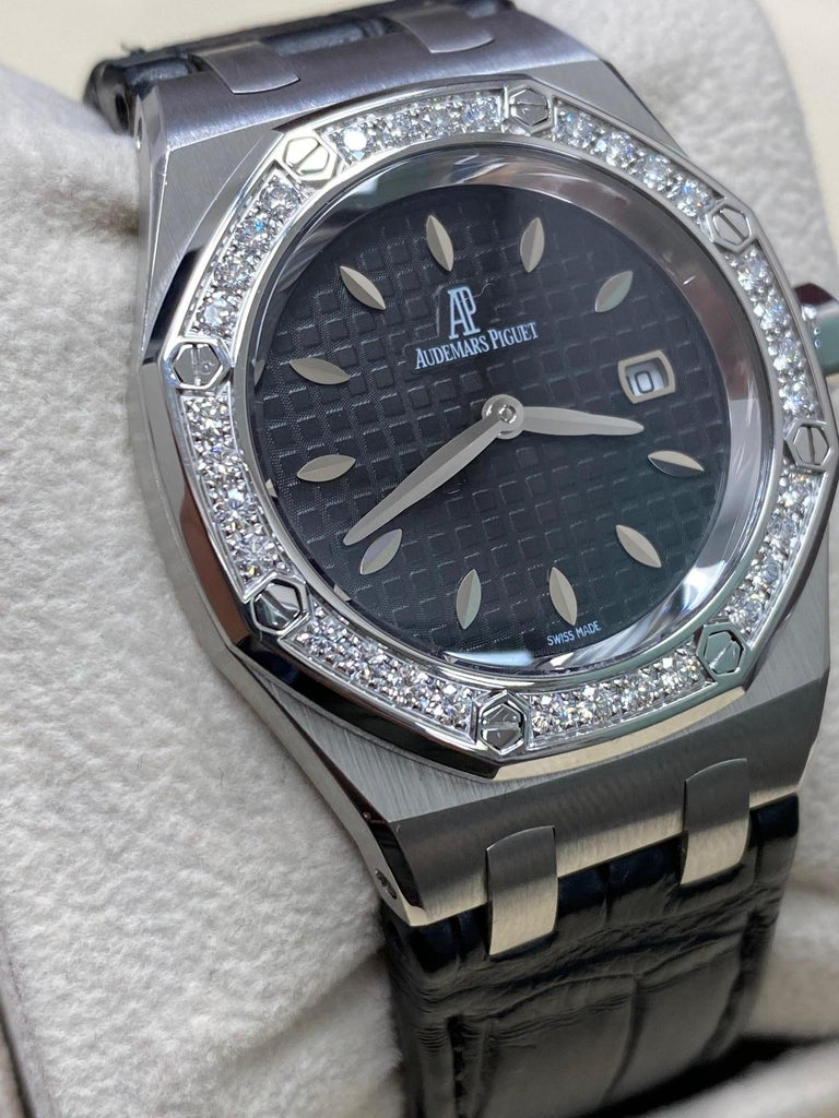 Style Number: 67651ST.ZZ.1261ST.01   Model: Royal Oak   Case Material: Stainless Steel   Band: Leather    Bezel:  Original Factory Diamond Bezel 0.71ctw    Dial: Black   Face: Sapphire Crystal   Case Size: 33mm  Retail: $17,700