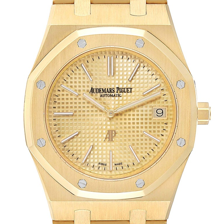 Audemars Piguet Royal Oak Yellow Gold Mens Watch 15202BA Box Papers. Automatic self-winding movement. 18K yellow gold hexagonal case 39 mm in diameter. Exhibition sapphire crystal case back. 18K yellow gold bezel punctuated with 8 signature screws.