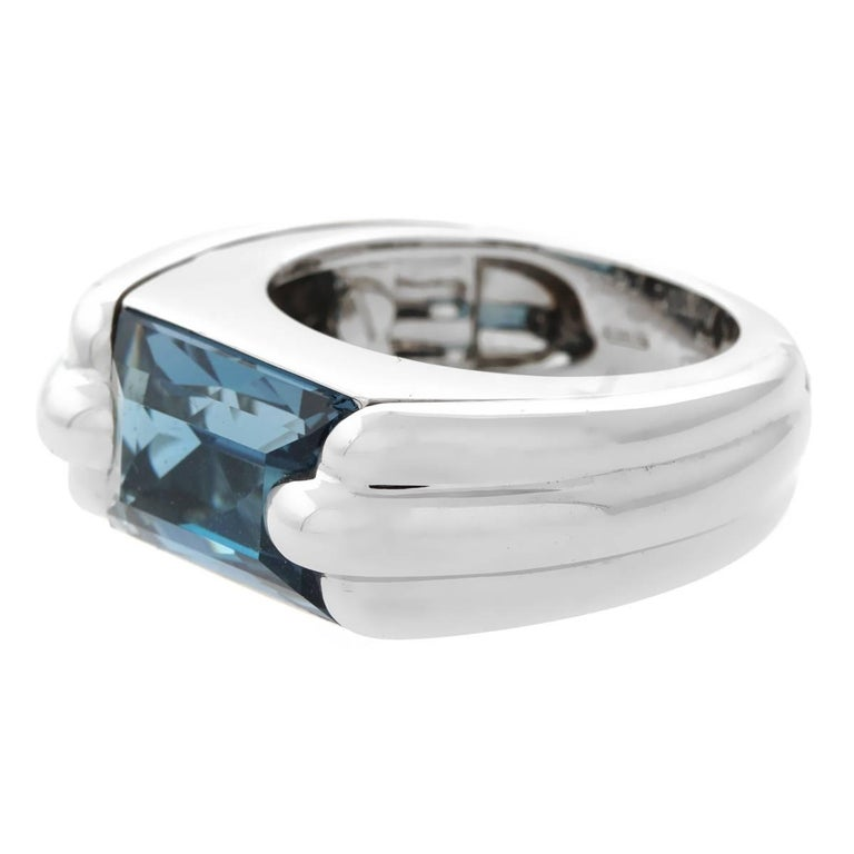 A chic Audemars Piguet ring featuring a blue topaz set in 18k white gold. Size 5.75  Sku: 876