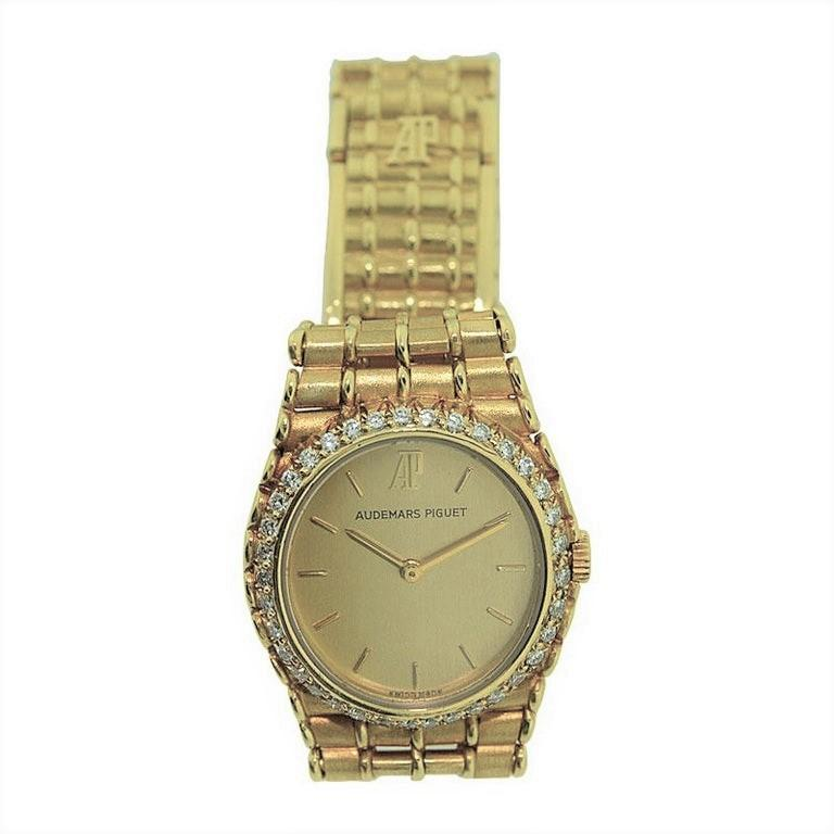 FACTORY / HOUSE: Audemars Piguet Watch Company STYLE / REFERENCE: Ladies Gold Bracelet Watch / Ref. C16465 METAL / MATERIAL: 18kt Yellow and White Gold  CIRCA: 1990's DIMENSIONS: 25mm X 22mm MOVEMENT / CALIBER: 7 Jewels / Quartz DIAL / HANDS: Gold