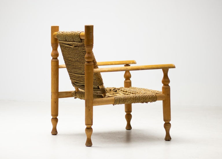 Adrien Audoux and Frida Minet lounge chair, made in France, circa 1950. Beech frame, seat and back in abaca rope with signature woven design.