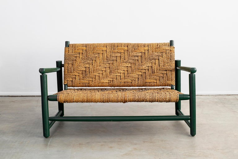Audoux Minet bench with woven rope seat and back. Wonderful patina with fantastic original green stained wood with patina.