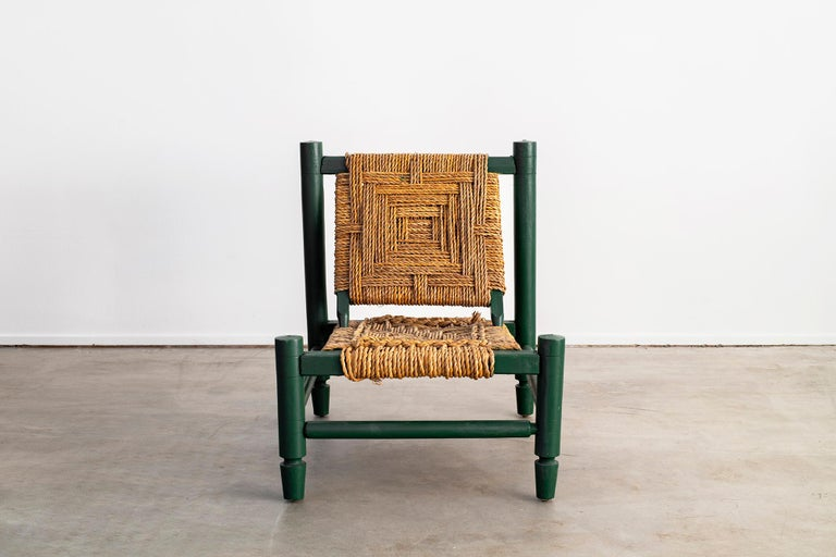 Audoux Minet chair with woven rope seat and back.