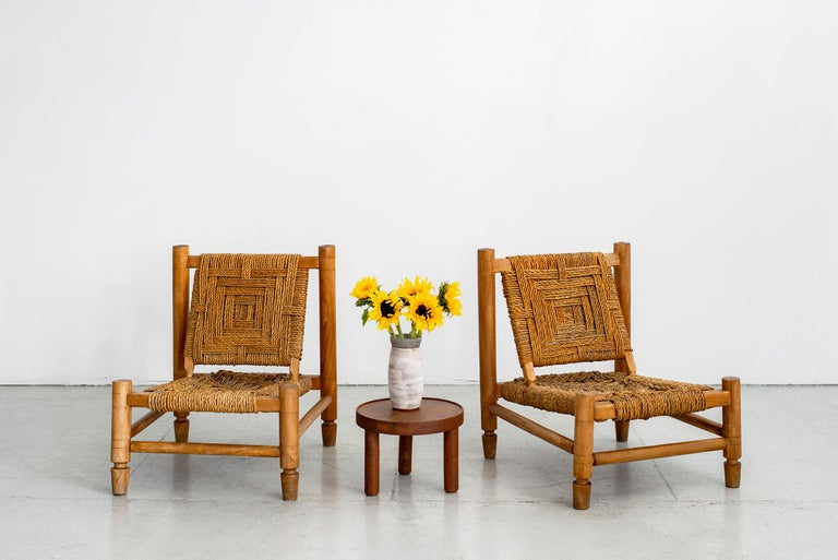 Pair of Adrien Audoux and Frida Minet low lounge chairs. Made of stained beech and abaca rope with beautiful woven design. Nice age and patina throughout.