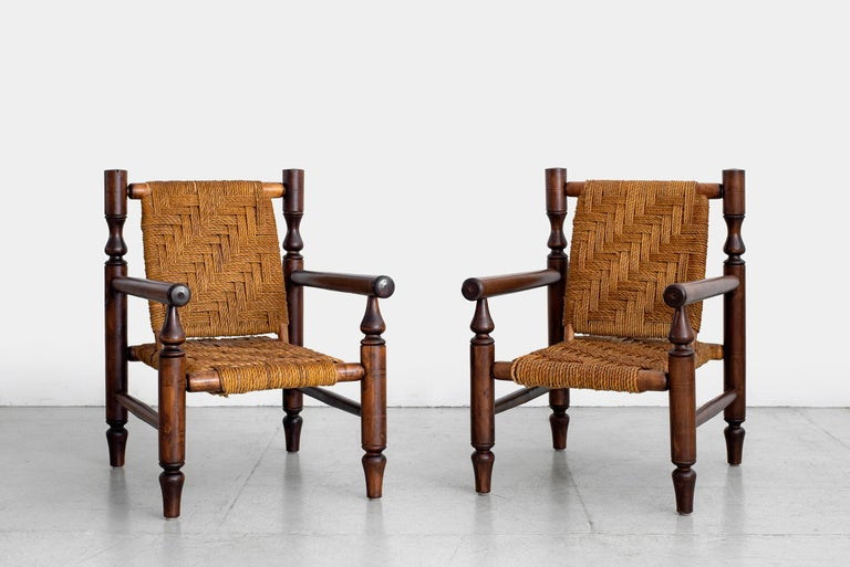 Wonderful pair of armchairs by Adrien Audoux and Frida Minet.  Made in France, circa 1950s.  Fantastic patina to wood  Beechwood and abaca rope.