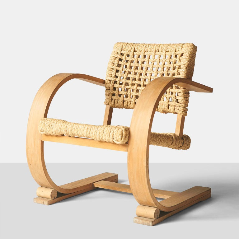 Pair of low slung rope chairs by Audoux-Minet featuring bentwood frames with braided rope seats and back rests.