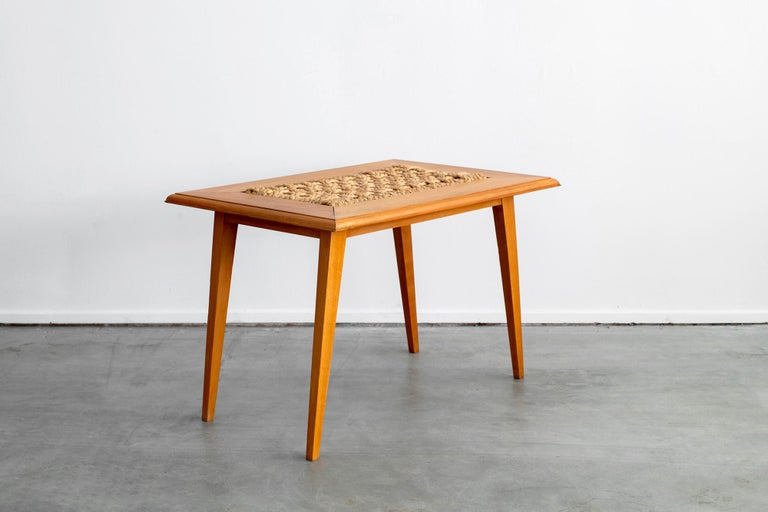 Wonderful Audoux Minet table with rope inlay and tapered legs.