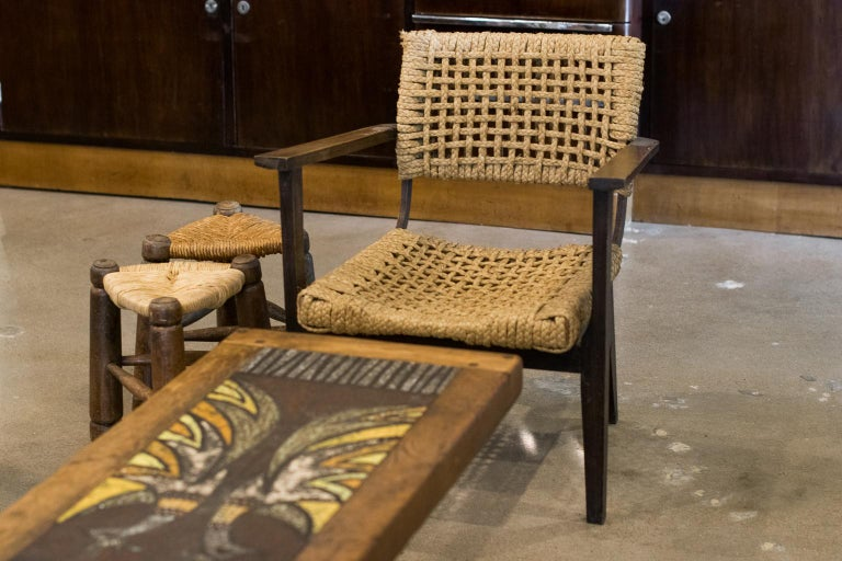 Wood framed armchair with seat and back of woven hemp rope from the abaca plant. These highly collectible rope pieces are typical of Audoux-Minet for Vibo, which was long established in Marseille, France, 1940s.