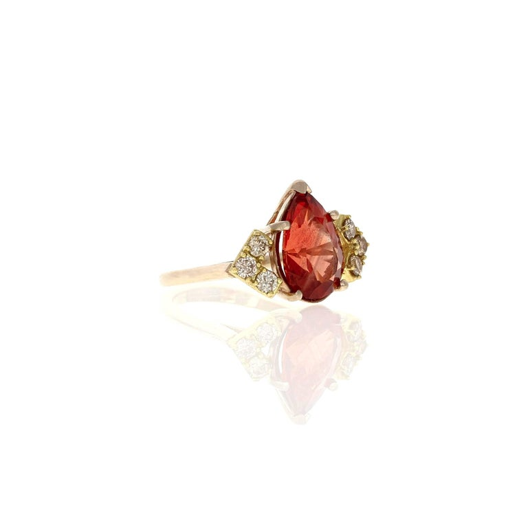 Focused around the colors of the Andromeda Galaxy and the stars above, we incorporate cognac diamonds, cradled around a unique one-of-a-kind red schiller Oregon sunstone. This ring in photos is a size 8 and ready to ship. Please contact for another
