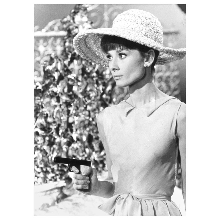 Audrey Hepburn on the set of Paris when it sizzles Vintage gelatin silver print by Vincent Rossell Photographer's credit stamp, Audrey Hepburn collection stamp and numerical notations verso From the Personal collection of Audrey Hepburn,
