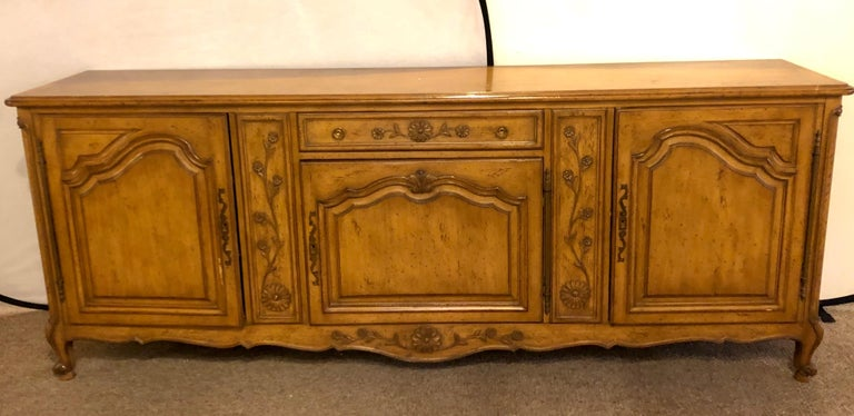 Auffray & Company, 18th century style Country French sideboard / buffet. This spectacular impressive and large sideboard has a center door which leads to three interior drawers the lower two with fitted burgundy velour fittings to hold your