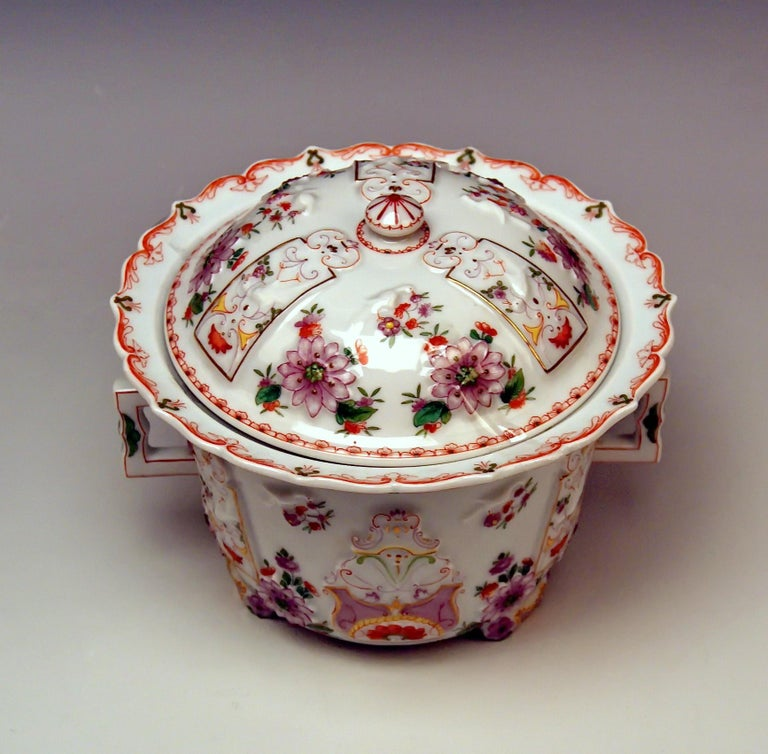 We invite you here to look at a splendid as well as rarest Augarten Vienna Porcelain item. It is a two-handled as well as lidded oil pot or candy box, made in Baroque style, strongly influenced by Asian (Chinese) art. Its wall made of white
