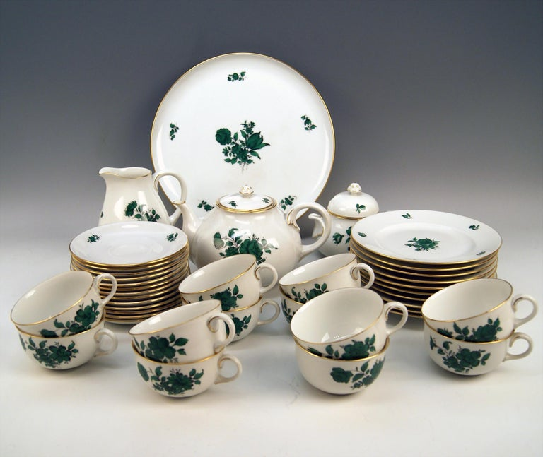 We invite you here to look at a splendid as well as nicest Augarten Vienna tea set for twelve persons:  This Augarten tea set is of finest elegance due to its delicate green monochrome paintings depicting various flower's blossoms with leaves as