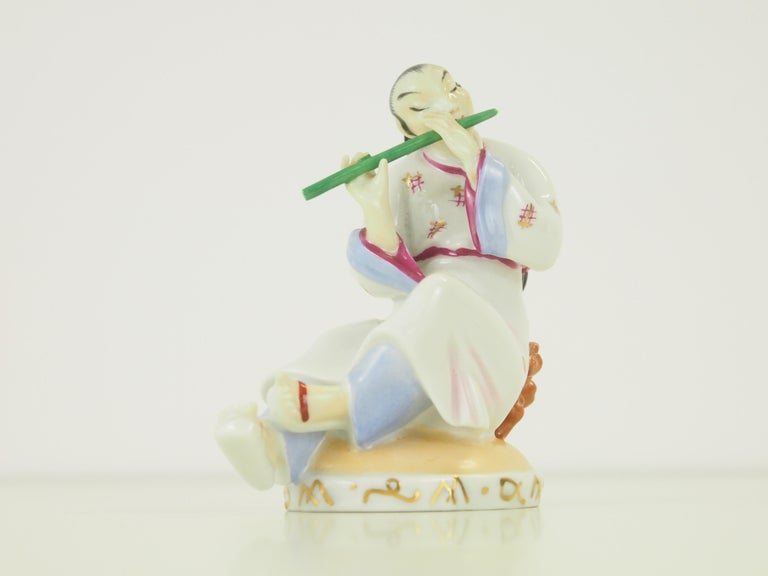 Austrian Augarten Wien Porcelain Figurine of a Chinese Man with Flute For Sale