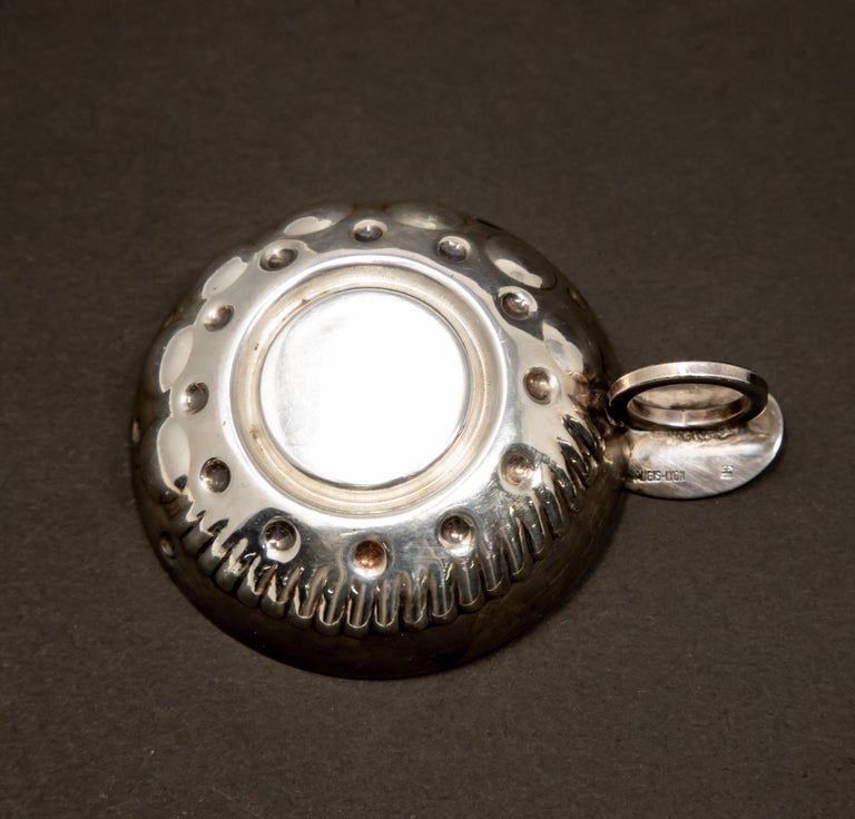 Offering this beautiful Augis-Lyon sterling silver wine taster. The inside medallion is motorized vehicle with Berliet 1897, and behind the back wheel is marked Augis. The handle is a ring with a plate on top. The back of this plate is marked with