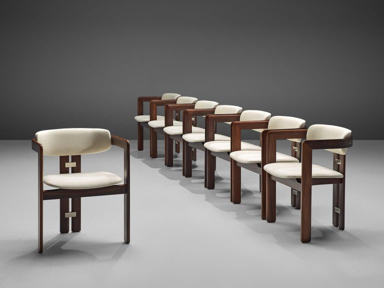 Augusto Savini for Pozzi, set of six 'Pamplona' dining room chairs, to be reupholstered, glossed wood and metal, Italy, 1965.   Set of six armchairs in dark glossed rosewood and white fabric upholstery. The chairs have a unique and characteristic