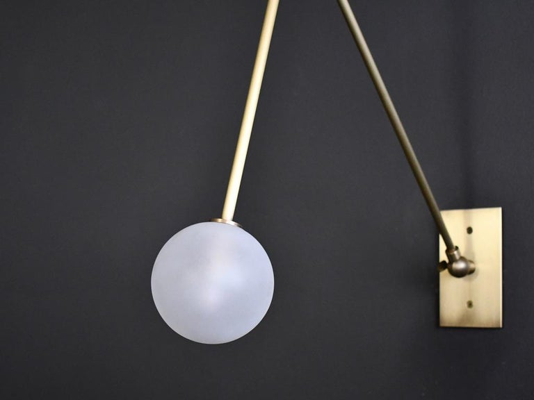 The Auguri wall lamp or reading light is handmade to order by Blueprint Lighting. Auguri is adjustable to suit your needs with it's two articulating joints. This design is strongly influenced by both French and Italian Mid-Century Modernism.  Enamel