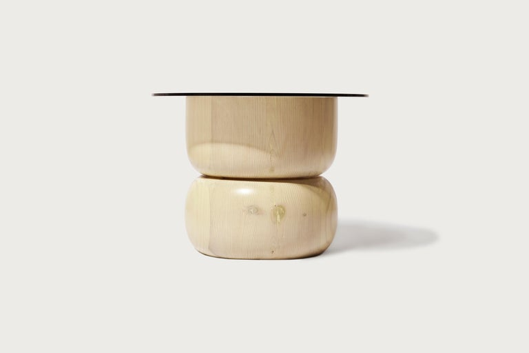 August opening side table by Panorammma Materials: wood, grey tint glass, silicone holdings.  Dimensions: 33 x 45 cm  Panorammma is a furniture design atelier based in Mexico City that seeks to redefine our relation to functional objects through