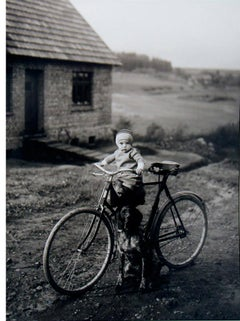 Farm Child on Bicycle