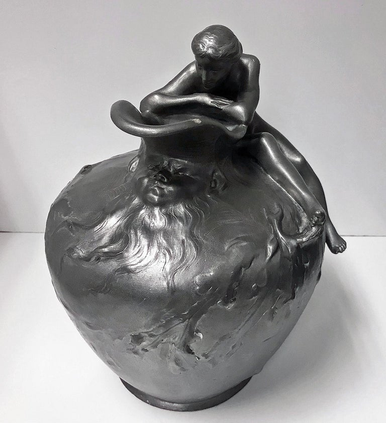 Auguste Ledru (1860-1902) Art Nouveau tinned Bronze Ewer Vase, modeled with a siren seated to the shoulder of the vase, a grotesque mask under the spout, a fish and seaweed trailing frieze, inscribed Susse Freres Paris Edition, stamped to the base