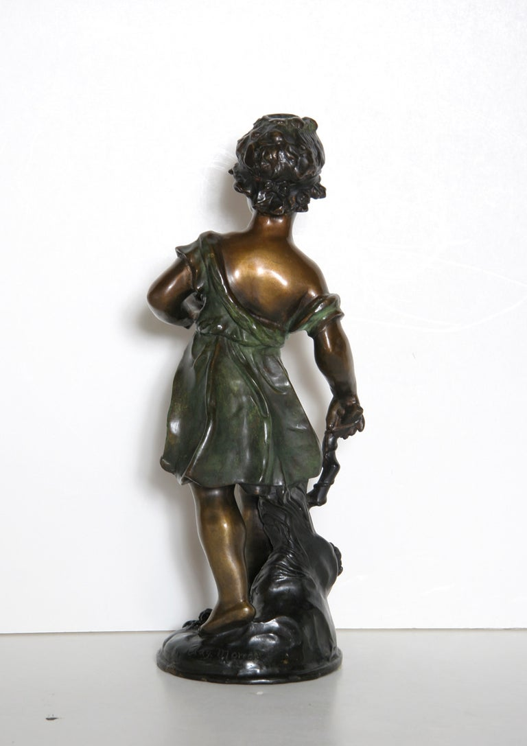 This bronze sculpture by Auguste Moreau is a beautiful work from the Romanticism period. Auguste was the third son of sculptor and painter Jean Baptiste Moreau.  In 1861, he made his debut at the Salon, where he would exhibit regularly until
