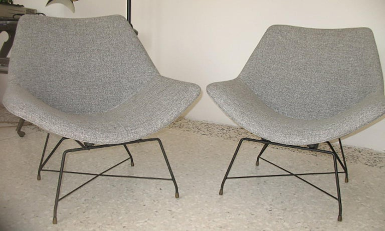 Armchairs with structure in lacquered iron and new fabric. designed By Augusto Bozzi for Saporiti in the 1950s.  Original label on the frame.