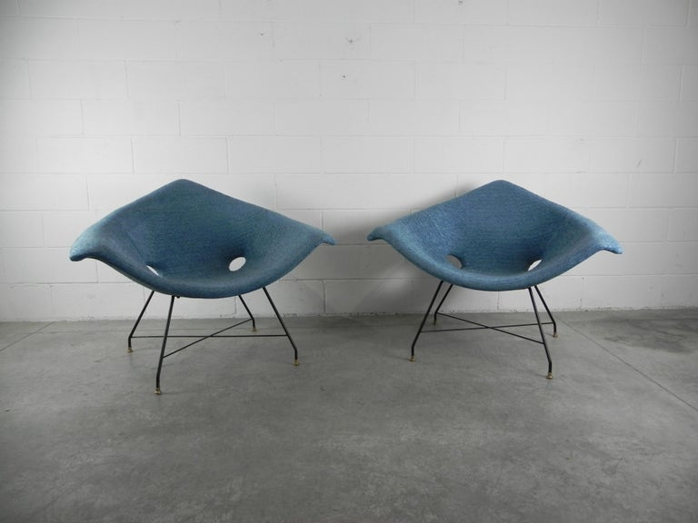 Rare pair of lounge chairs designed by Augusto Bozzi for Saporiti Italia, Italy, 1954. The chairs have a black lacquered metal base with solid brass feet and are newly upholstered. Makers label to underside.