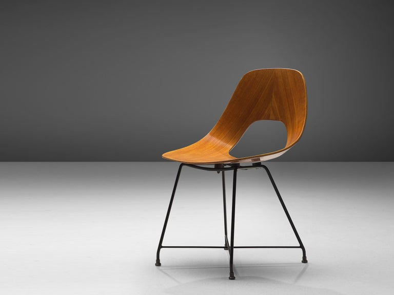 Augusto Bozzi for Saporiti, 'Ariston' dining chair, teak, steel and brass, Italy, 1957.  Elegant 'Ariston' chair designed by Augusto Bozzi for Saporiti. The chair is made out of a solid bend plywood piece of teak in an elegant shape, which provides