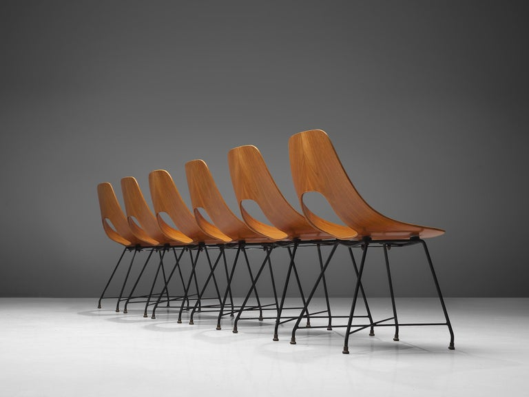 Augusto Bozzi for Saporiti, set of six 'Ariston' dining chairs, teak, steel and brass, Italy, 1957.  Elegant set of six 'Ariston' chairs designed by Augusto Bozzi for Saporiti. The chairs are made out of a solid bend plywood piece of teak in an
