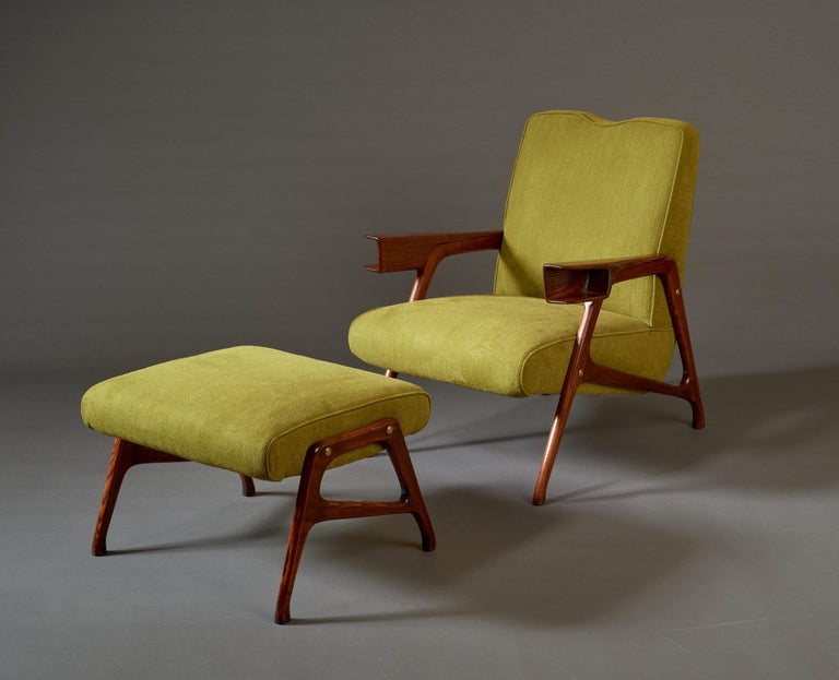 Augusto Romano (1918-2001)  A stunning armchair and ottoman set by Torinese modernist architect Augusto Romano, in mahogany with brass detailing, upholstered in a deep chartreuse. An architectonic, rounded A-line frame culminates in tapering legs