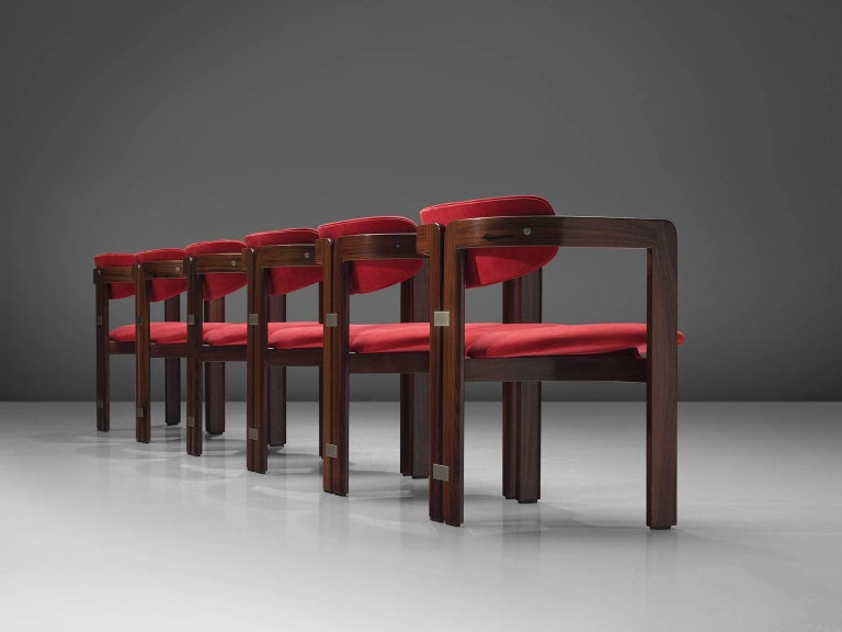 Augusto Savini, set of six 'Pamplona' dining room chairs, in rosewood and red suede, by for Pozzi, Italy, 1965.   Set of six armchairs in rosewood and red suede upholstery. A characteristic design; simplistic yet very strong in lines and