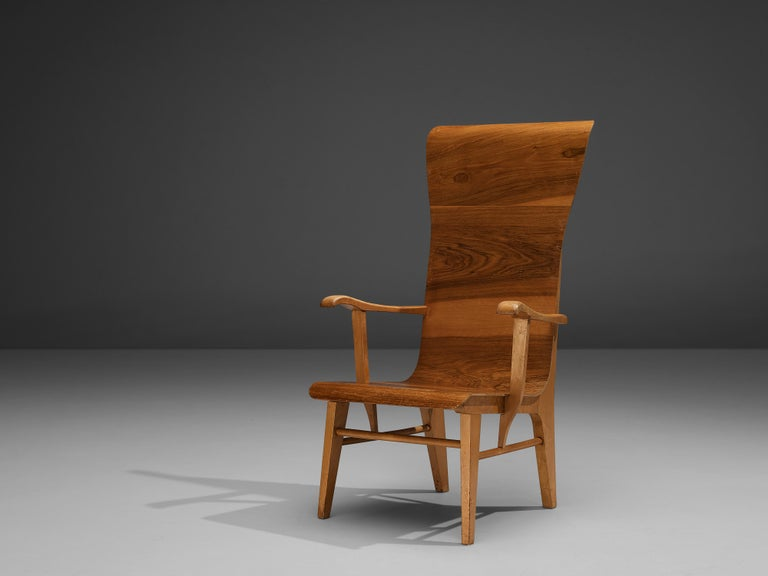 Auke Komter for Metz & Co, chair, beech, plywood, walnut, the Netherlands, 1930s  This stately chair was designed by Dutch Architect Auke Komter in the early 1930s. The armchair is made from a solid beech frame with bend plywood shell that flows