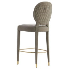 Aurea Bar Stool with Upholstered Legs and Back Details