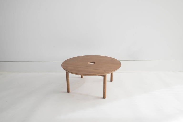 Sun at Six is a Brooklyn design studio. We work with traditional Chinese joinery masters to handcraft our pieces using traditional joinery. Handcrafted using traditional joinery. Our classic round coffee table. We use exposed tenons throughout.  •