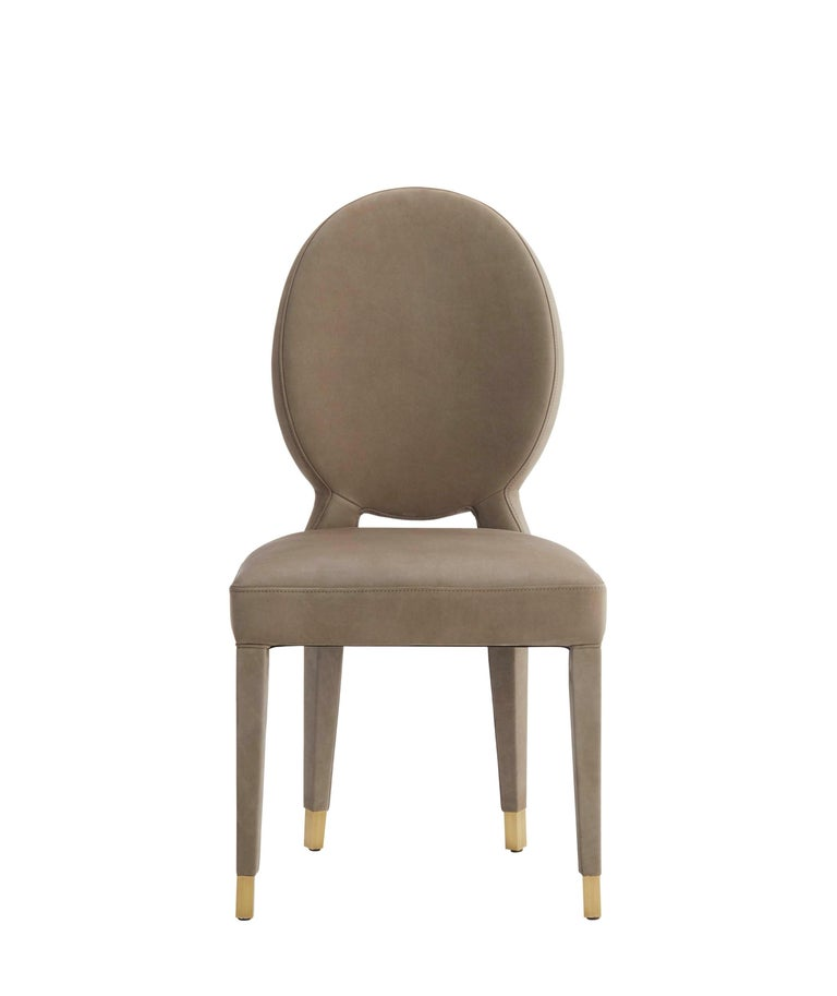 Modern Aurea Dining Chair Upholstered in Leather with Antique Brass Tips For Sale