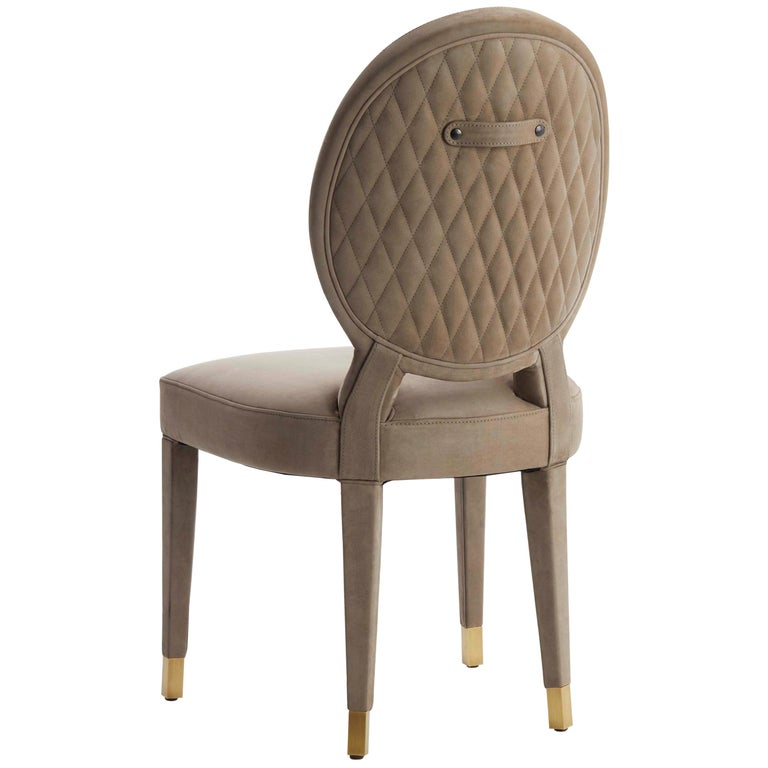Aurea Dining Chair Upholstered in Leather with Antique Brass Tips For Sale