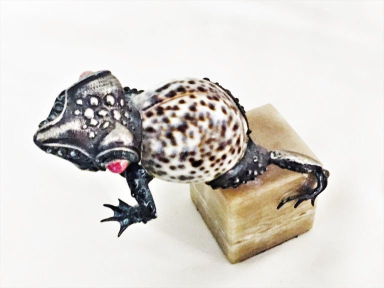 """A group of four silver, sea shell and coral Animal sculptures 1950s.  Dimensions: Frog – H 5"""" x W 2.5"""" x D 5"""" x base height 2"""" Bird – H 6"""" x W 5"""" x D 3.5"""" x base height 2"""" Dog – H 4"""" x W 2.33"""" x D 3.5"""" x base height 0.75"""" Turtle – H 2.75"""" x"""